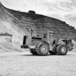 Stone pit with industrial vehicle at work — Stock Photo