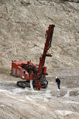 Stone pit with industrial vehicles at work — Stock Photo