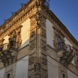 The Baroque Beneventano Palace facade at sunset - Stock Photo