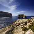 Malta Island, Gozo, Dweira Lagoon, tourists enjoy the view of the rocky coastline near the Azure Window Rock — Stock Photo