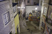 Portugal, Lisbon, Alfama area, view of a small street and a Fado mural at night — Stock Photo