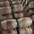 Stock Photo: Wooden wine barrels in a wine cellar