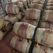 Italy, Sicily, Ragusa Province, wooden wine barrels in a wine cellar - Stock Photo