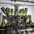 Italy, Sicily, wine bottles ready to be washed and filled with wine by an industrial machine in a wine factory - Stockfoto