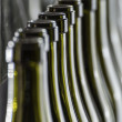 Italy, Sicily, wine bottles ready to be washed and filled with wine by an industrial machine in a wine factory - Stock fotografie