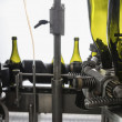 Italy, Sicily, wine bottles being washed and filled with wine by an industrial machine in a wine factory - Stock fotografie