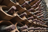 Italy, Sicily, Ragusa Province, wooden wine barrels in a wine cellar — Stock Photo