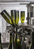 Italy, Sicily, wine bottles ready to be washed and filled with wine by an industrial machine in a wine factory — Stock Photo