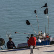 Stock Photo: Sicilifishermen in port