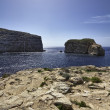 View of the rocky coastline near the Azure Window Rock - Stock Photo