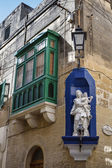 Victoria city, typical maltese window and a religious statue — Stock Photo