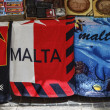 Maltese gadgets and beach towels  for sale in a store - Stock Photo