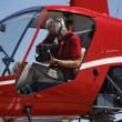 Stock Photo: Movie operator filming from helicopter