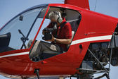 Movie operator filming from a helicopter — Stock Photo