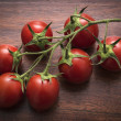Tomatoes on a wooden table — Stock Photo