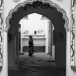 India, Rajasthan, Pushkar, private house entrance, indian woman — Stock Photo #30481551