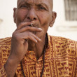 Smoking indian man — Stock Photo