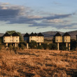 Kenya, Taita Hills National Park, Taita Hills Resort Lodge bungalows at sunset — Stock Photo