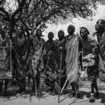 Kenya, Tsavo East National Park, Masai village, Masai men dancing — Stock Photo #32941125