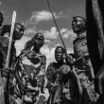 Kenya, Tsavo East National Park, Masai village, Masai men dancing — Stock Photo #32941233