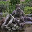 Baroque statue in the garden's fountain — Stock Photo