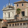 Roman church facade and old building — Stock Photo #35718457