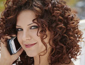 Young woman on the phone — Stock Photo