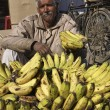 Indian man selling bananas in a local market — Stock Photo #38079865
