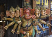 Wooden hindu Ganesh God statue for sale in a local store — Stock Photo
