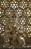 Old hindu religious statue in a street altair — Stock Photo