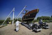Luxury yacht hauling in a boatyard — Stock Photo