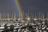 Yachts in the marina with a rainbow — Stock Photo