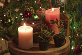 Candles and Christmas tree decorations — Stock Photo