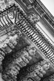 Baroque ornamental statues under the balconies — Stock Photo