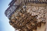 Baroque ornamental statues under the balconies — Stockfoto