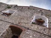 Italy, tuscany, Capalbio, small windows on the external walls of the old town — Stock Photo