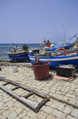 Fisherman working ashore on his fishing boat — Stock Photo