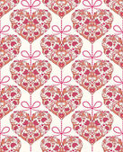 Seamless pattern with floral colorful hearts — Stock Vector