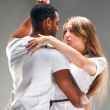 Stock Photo: Young couple dances Caribbean Salsa
