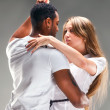 Young couple dances Caribbean Salsa — Stock Photo #13973638