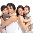 Happy multiracial family of four - 