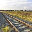 Scenic railroad in rural area at sunset — Stock Photo