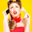 Pin-up girl talking on retro telephone — Stock Photo #29838013