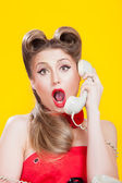 Pin-up girl talking on retro telephone — Stock Photo