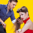 Professional hairdresser with long hair model — Stock Photo