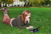 Adult woman with tablet pc, outdoors — Stock Photo