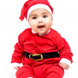 Little  baby girl  in red Christmas clothes. — Стоковая фотография