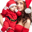 Mom and baby dress as santa — Stock Photo