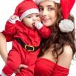 Mom and baby dress as santa — Stock Photo