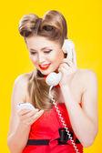 Pin-up girl talking on retro telephone — Stock Photo